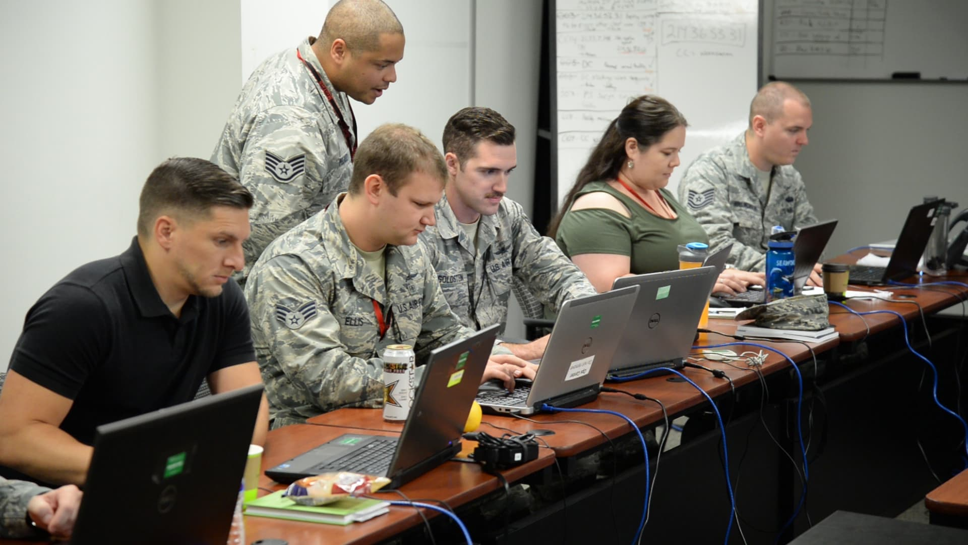 DISA employees working on-site in office