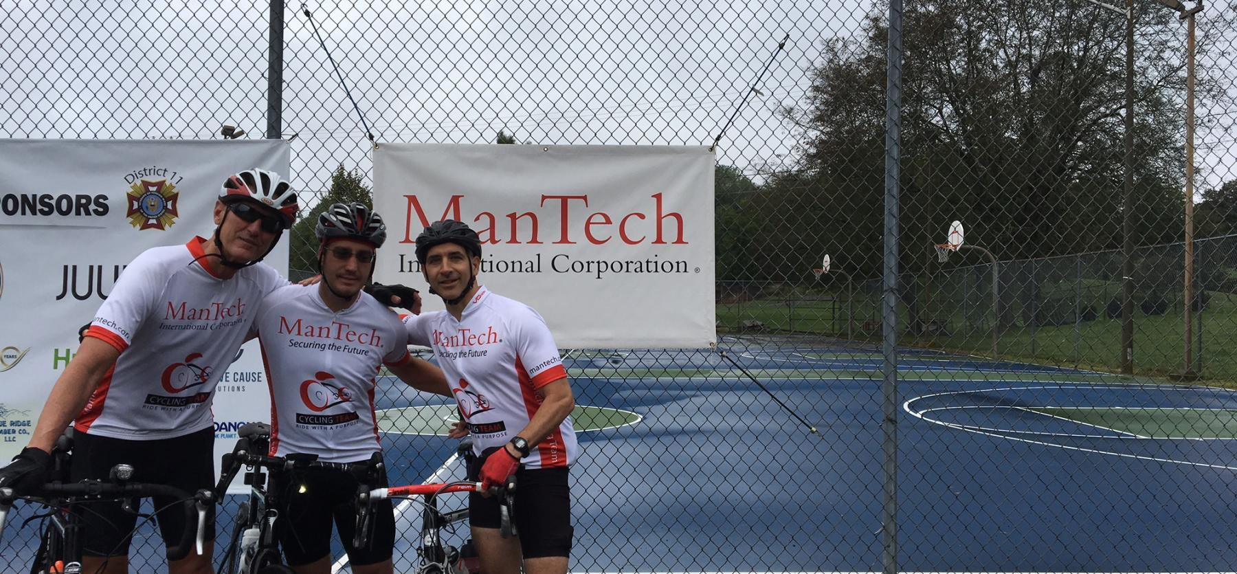ManTech employees on bicycle