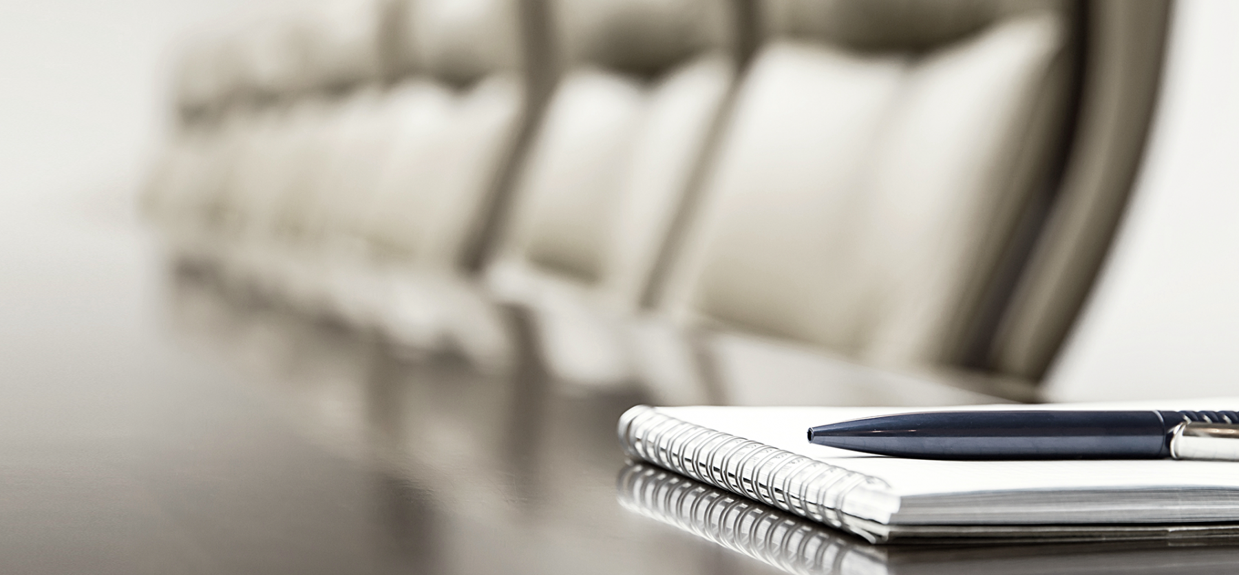 pen and notebook on conference table